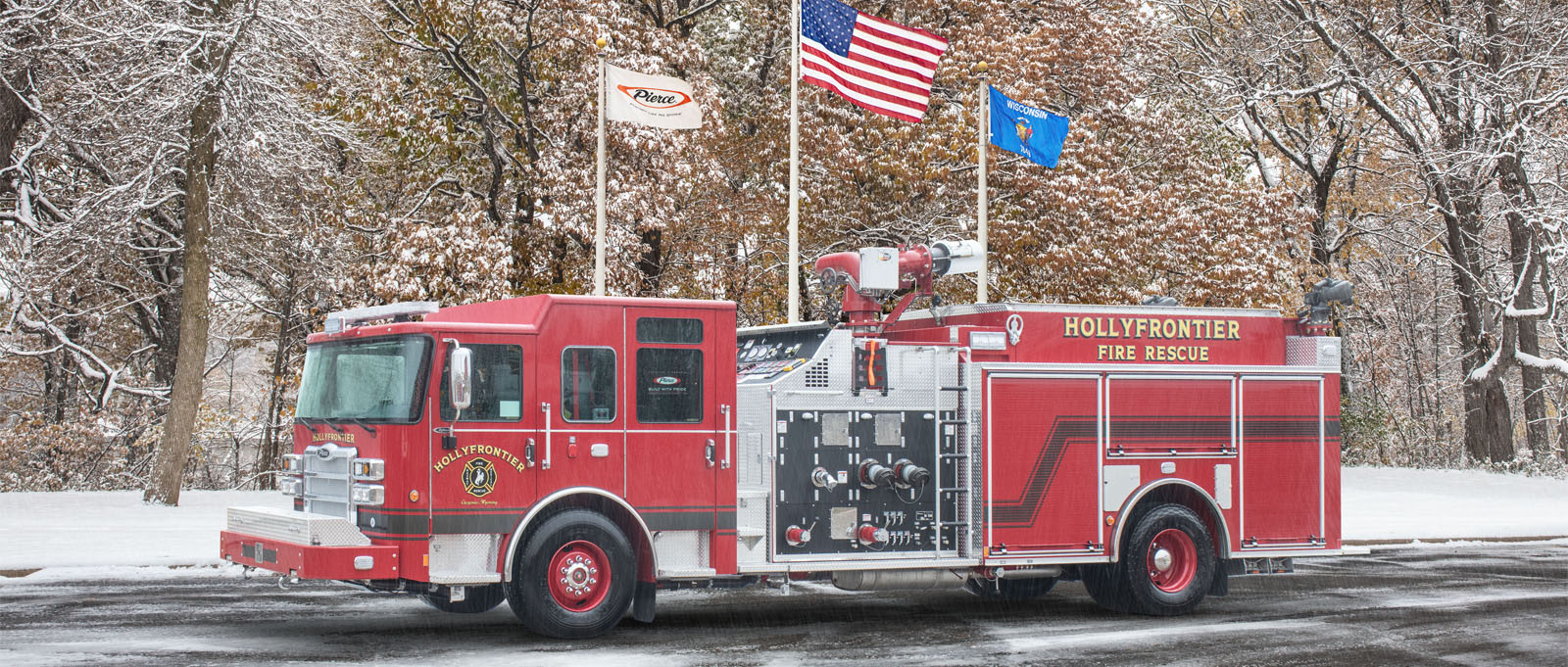 The red HollyFrontier pumper truck is pictured parked in a lot with flags flying in the background.