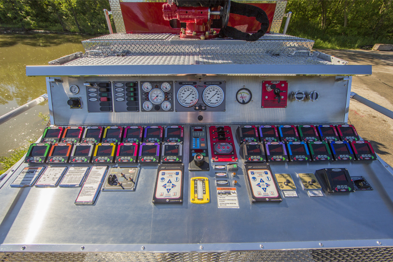 A close up view of the operator panel of an industrial fire truck.