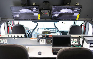 Interior view of the Command Rescue Apparatus showing four seats and monitors of camera footage.