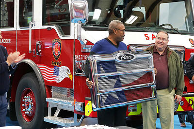 A Pierce customer receives a custom Pierce grille with a flag painted on it.
