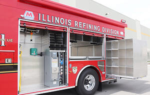 Side view of a Pierce Manufacturing Encore Rescue Truck.  Showcasing how compartments are built transversely, or crosswise, instead of lengthwise.