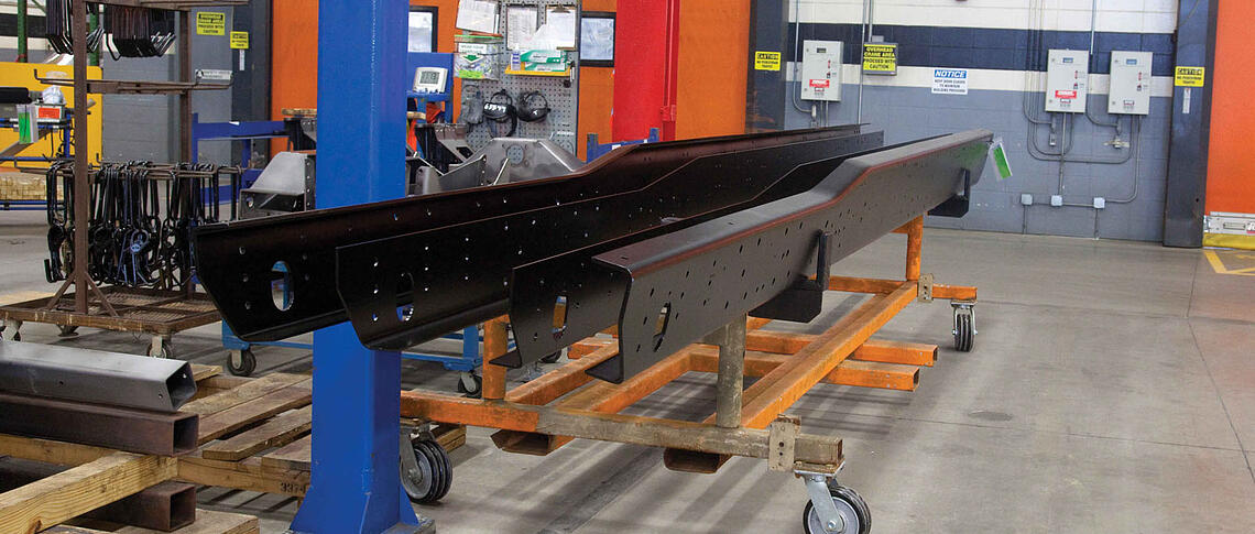 Fire truck undercarriage components and frame rails drying after the electrocoating process.