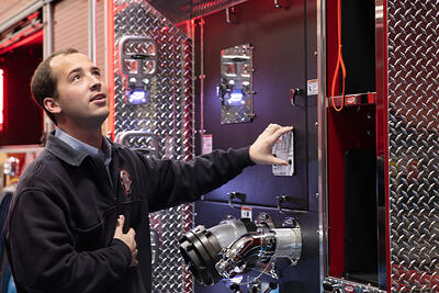 Pierce provides to their dealers educated and experienced sales and service members, pictured is a young man showing technical support on a fire apparatus