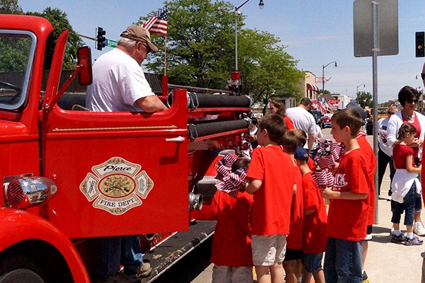 Flag-Day-Parade_Community-Impact