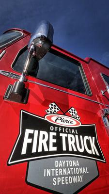 An Official Fire Truck Sponsor Door Graphic on the door of a Daytona International Speedway Pierce Fire Truck