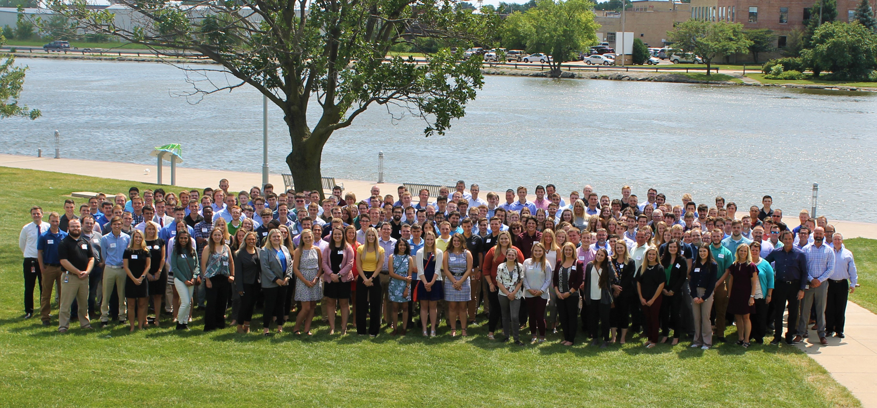 Group shot of Pierce interns and mentors all standing outside