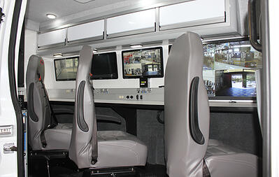 Interior view of the CRU22 Rescue showing an incident command center with counter space and monitors