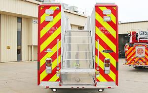 Rear view of a Pierce Manufacturing Walk-in Rescue Truck. Rear view showing steps that lead to the top of the apparatus.