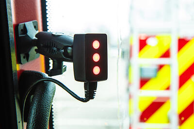 A close up shot of the HAAS Alert system that has been installed in an emergency vehicle.