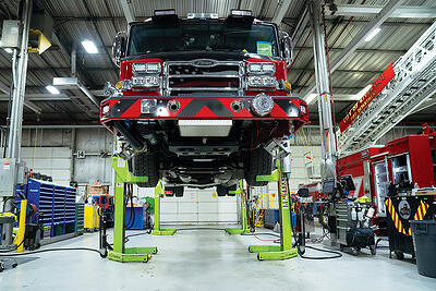 Pierce fire truck service training classes show a fire apparatus on a lify