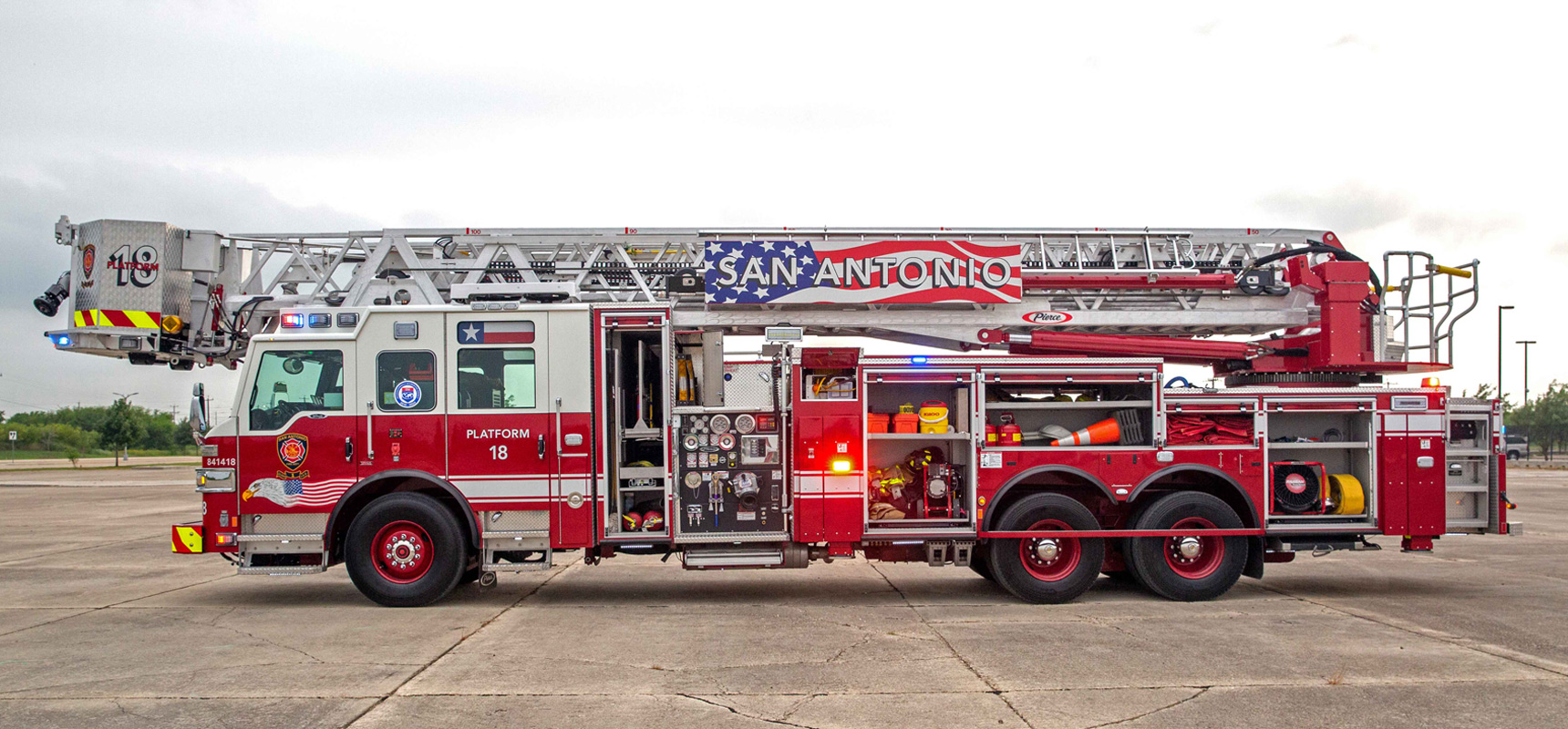 A fire truck featuring versatile transverse compartments and storage over the pump.