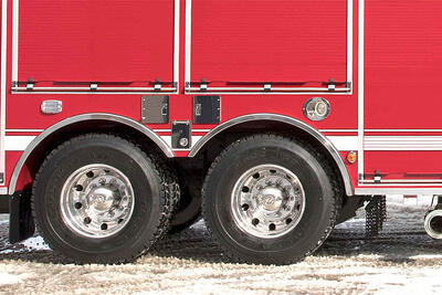 Pierce Manufacturing fire apparatus has tire chains shown under the body of the truck along with other cold weather features.