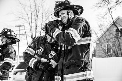 firefighters-outdoorsFirefighters in a candid moment horsing around in turnout gear outdoors.