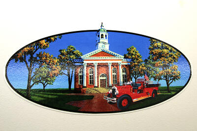 Hand painted fire truck graphic of an old schoolhouse and vintage car in a country setting.