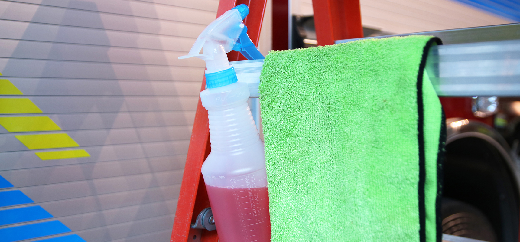 Fire apparatus being washed with a microfiber sponge using Pierce's five tips