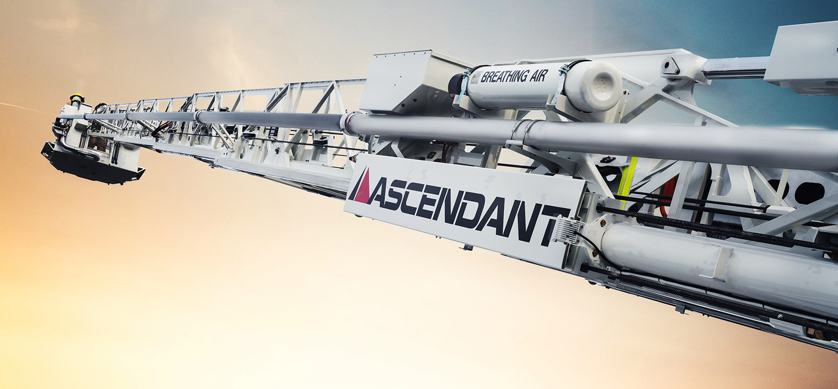 An ascendant aerial device is fully-extended in the air, showing the heavy-duty 100K psi high-strength steel design.