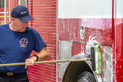 Washing fire apparatus regularly with a warm water and soapy solution can help remove de-icing agents.