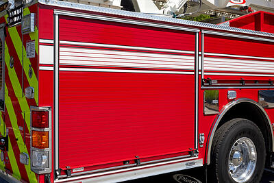 A red and white fire truck roll up door shows the door construction detail.