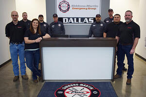 Siddons-Martin team members in entryway at one of three new service centers.