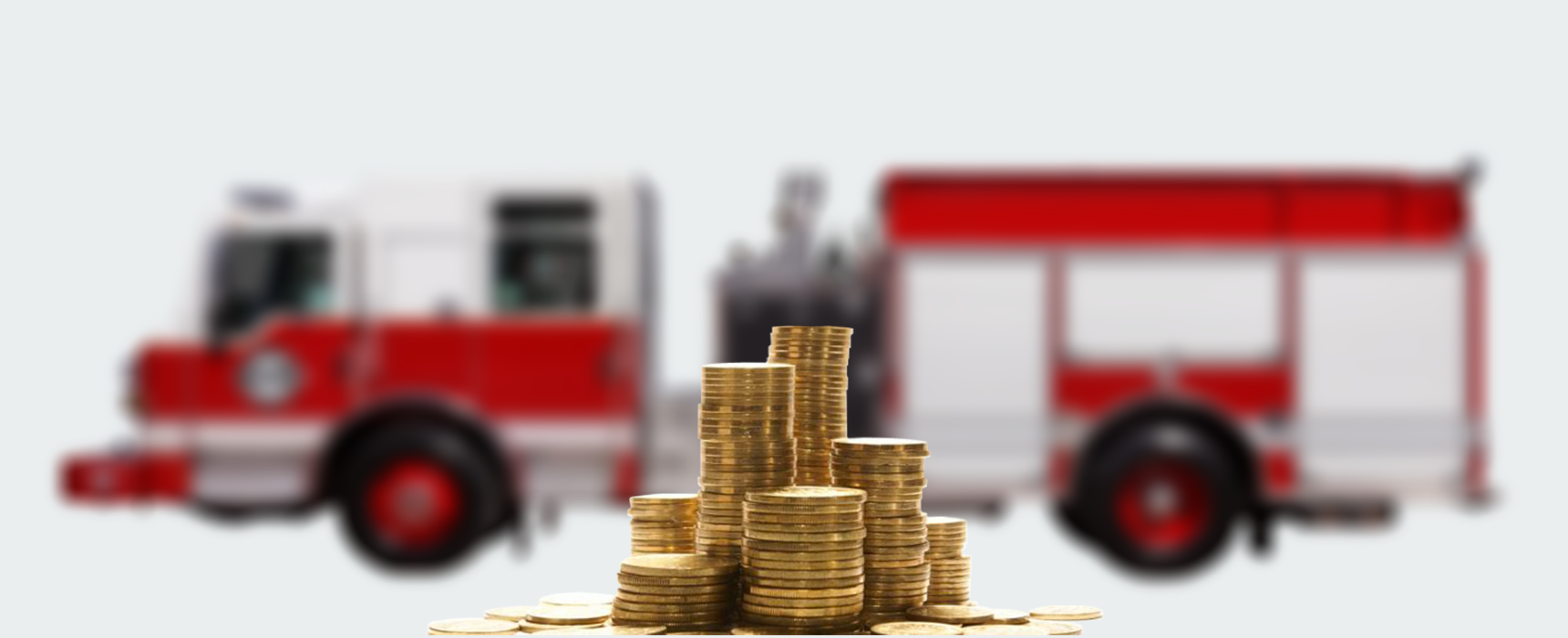 Focussed , close up image of coins with a blurred background of a Pierce firetruck available for leasing purchase programs.